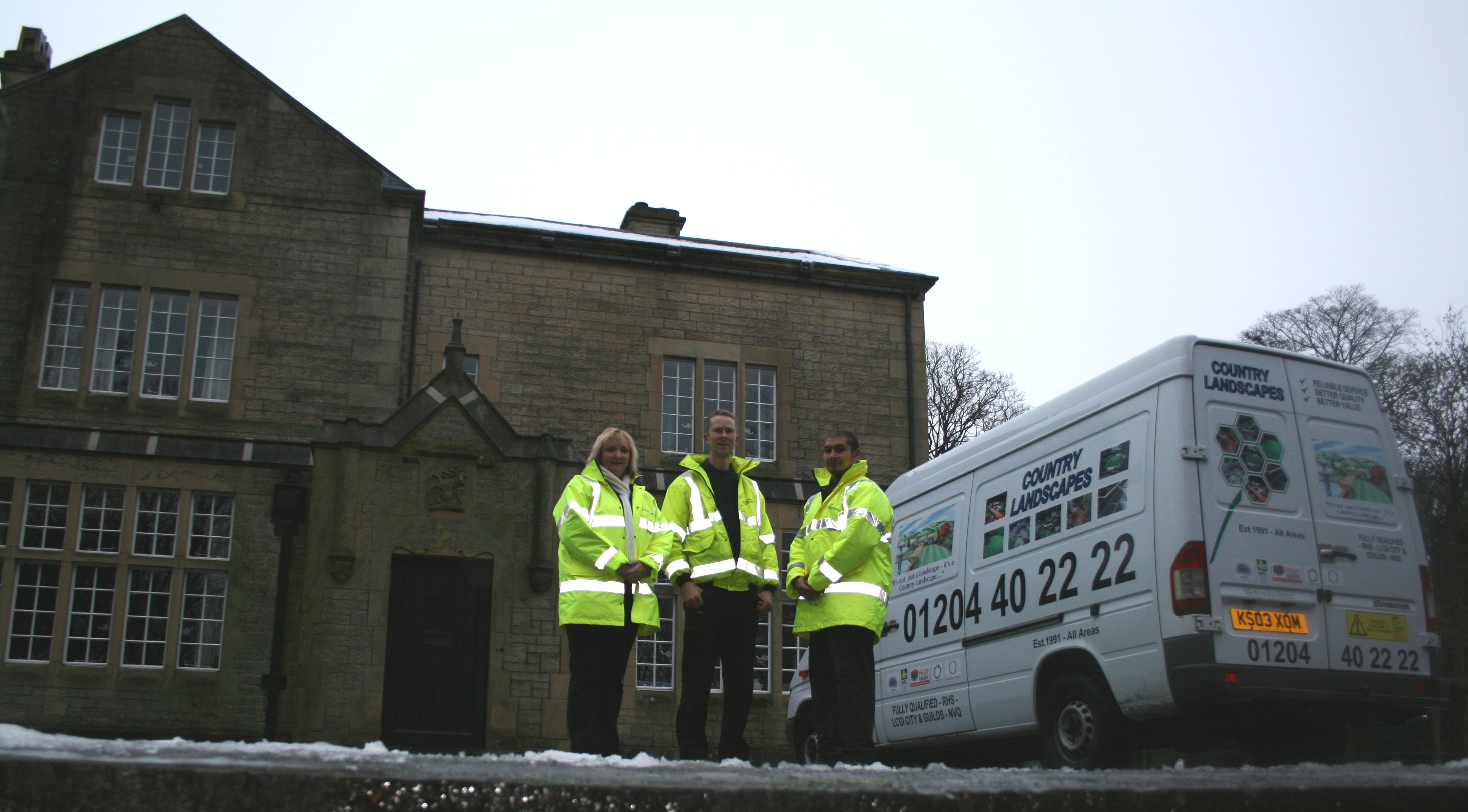 some of the team who worked at Tor Side including Anita Lee and Mick pictured with new van signage and logo